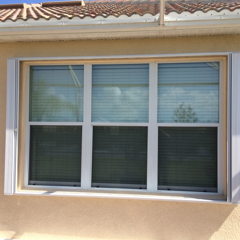 Accordion shutters naples marco island ft myers fl for Sliding glass doors accordion